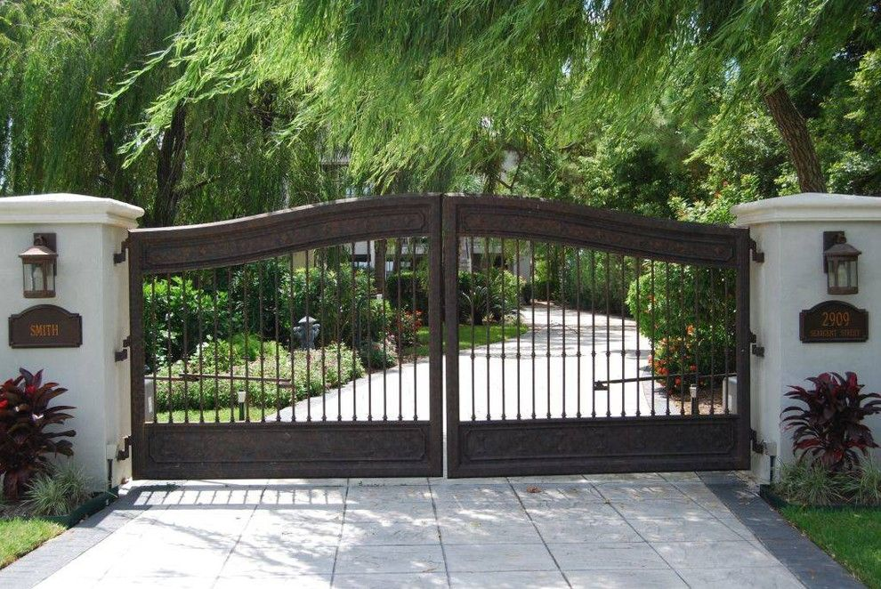 Southgate Glass for a Mediterranean Landscape with a Concrete Driveway and Residential Fence Projects by Fencemaster