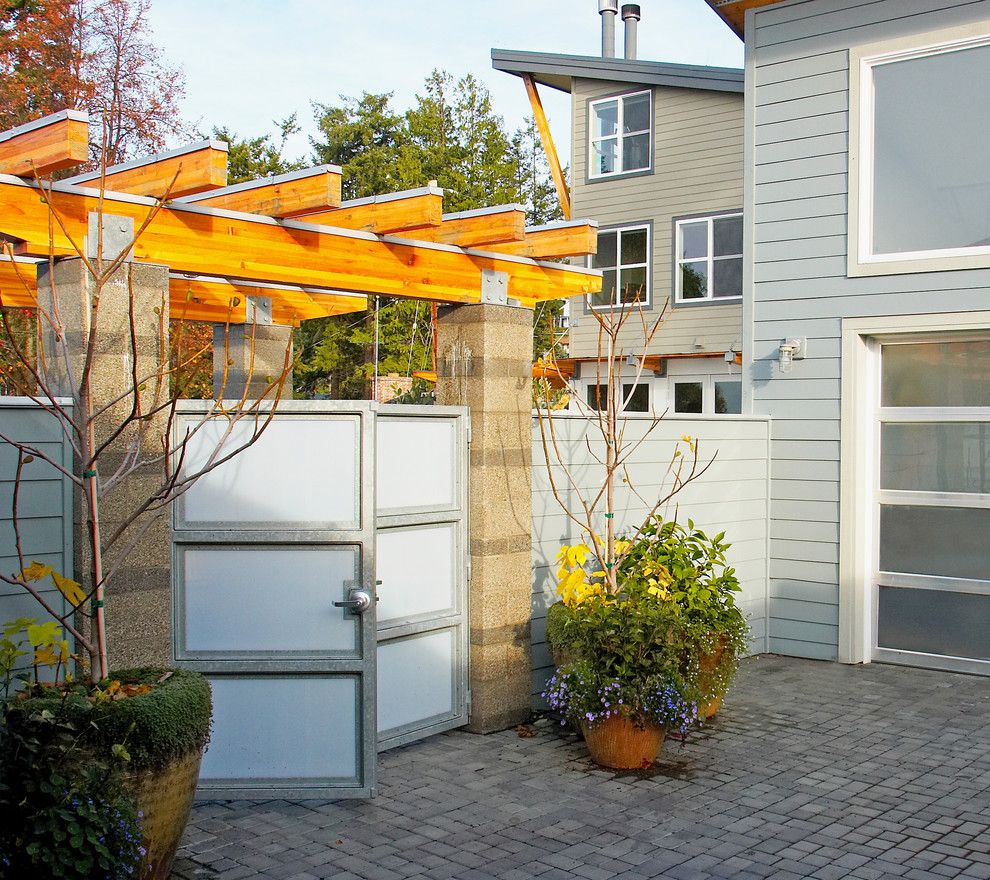 Southgate Glass for a Modern Landscape with a Front Gate and Courtyard Gate. the Hannon Residence is in the Background.. by Dan Nelson, Designs Northwest Architects