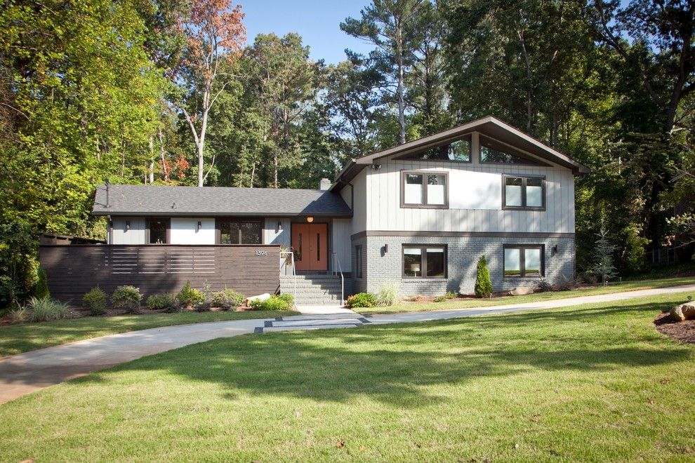 Split Level Remodel for a Midcentury Exterior with a Neutral Colors and Mid Century Modern Atlanta by Valboyd