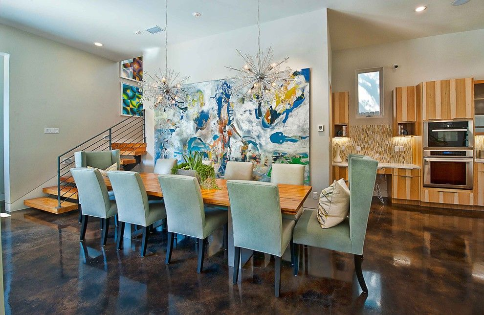 Stained Concrete Floors for a Contemporary Dining Room with a Artwork and Bowman Dining by Cornerstone Architects