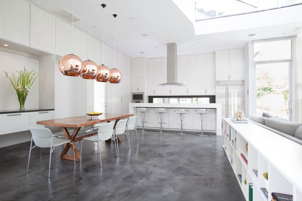 Stained Concrete Floors for a Contemporary Kitchen with a Trestle Table and Memorial Park Modern by Laura U, Inc.