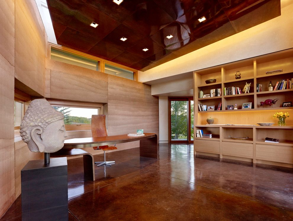 Stained Concrete Floors for a Modern Home Office with a Leather Task Chair and Trader Office Addition by Carney Logan Burke Architects