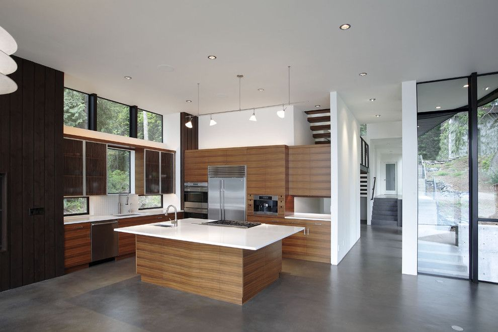 Stained Concrete Floors for a Modern Kitchen with a Wood Cabinets and David Vandervort Architects Aia by David Vandervort Architects