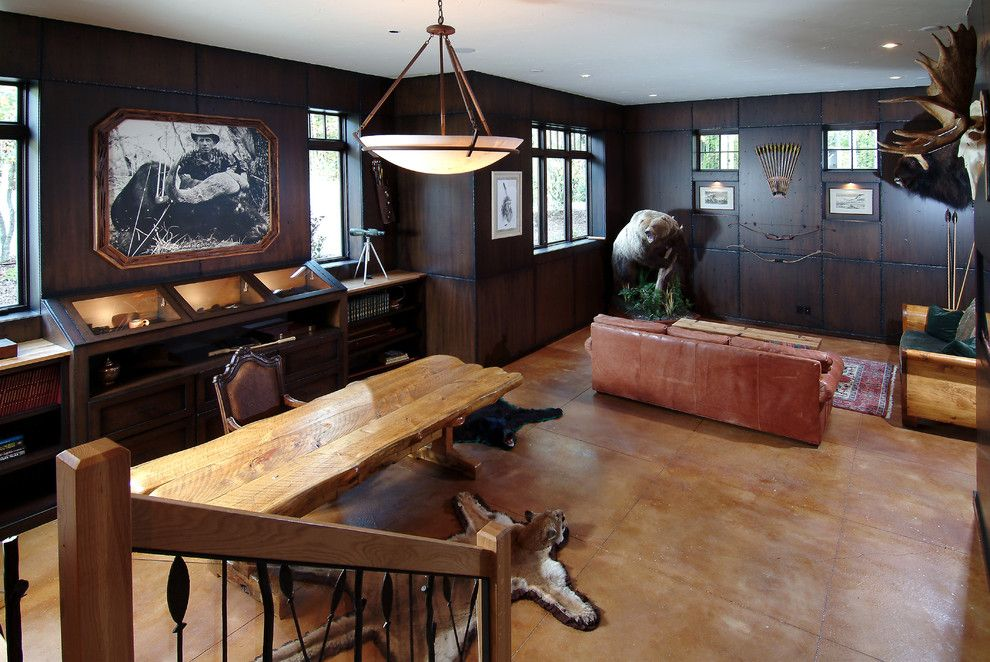 Stained Concrete Floors for a Traditional Family Room with a Trestle Table and Wild Game Room by Visbeen Architects