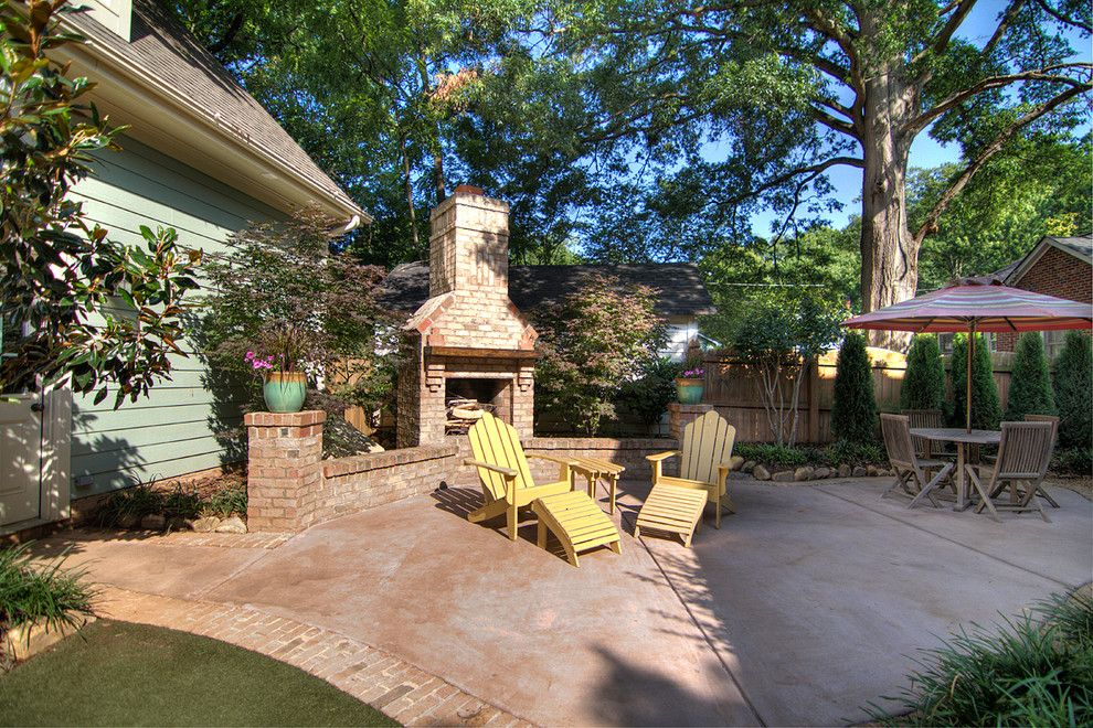 Stained Concrete Patio for a Traditional Patio with a Plants and Chantilly Cottage by Grandfather Homes