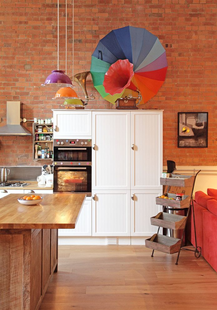Staining Brick for a Eclectic Kitchen with a Colourful Pendant Light and Eclectic Stoke Newington Apartment by Avocado Sweets Interior Design Studio