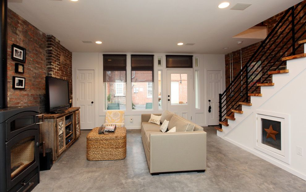 Staining Brick for a Rustic Living Room with a Sofa and Urban Lofts by Frazier Associates
