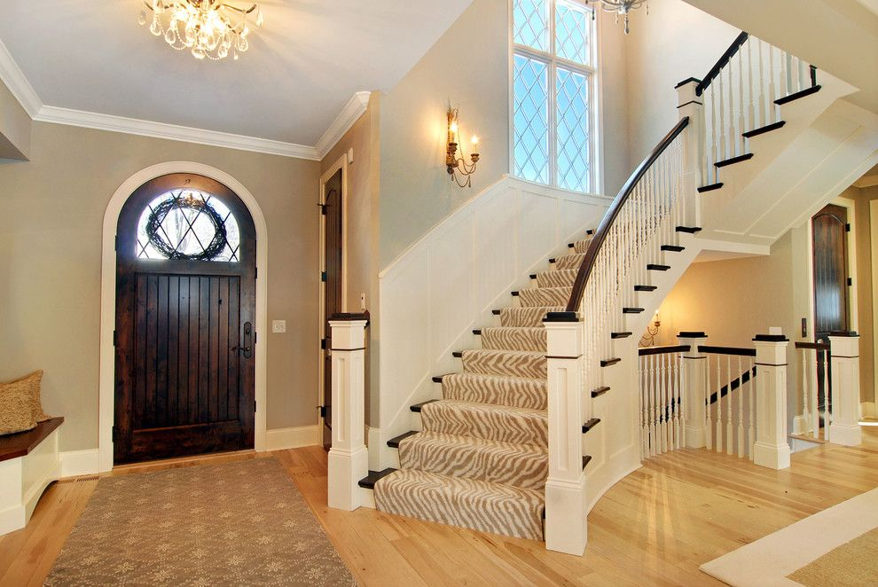 Stanton Carpet for a Eclectic Entry with a Built in Bench and Great Neighborhood Homes by Great Neighborhood Homes