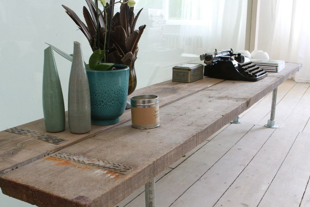Stardust Building Supplies for a Contemporary Spaces with a Steel and Salvaged Wood Media Bench and Industrial Reclaimed Scaffolding Plank and Steel Pipe Bespoke Furniture/fittings by Urban Grain