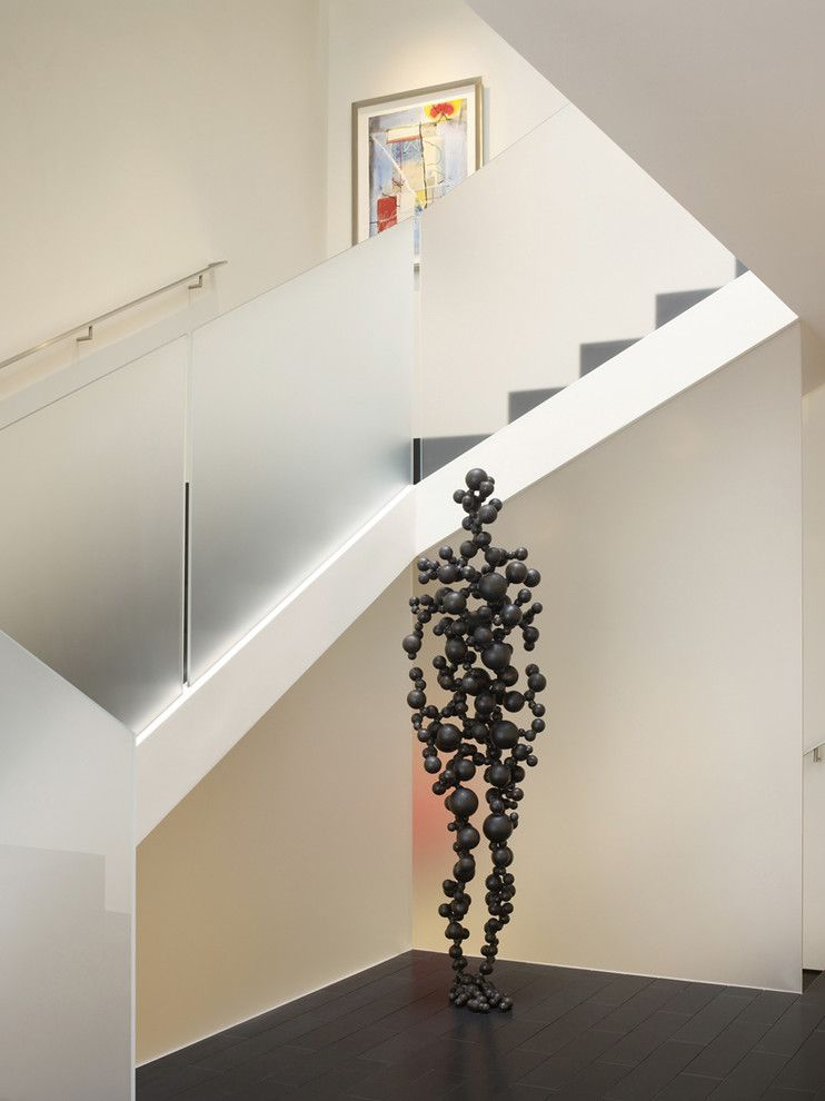 Starfire Glass for a Contemporary Staircase with a Dark Floor and Cow Hollow Modern by Matarozzi Pelsinger Builders