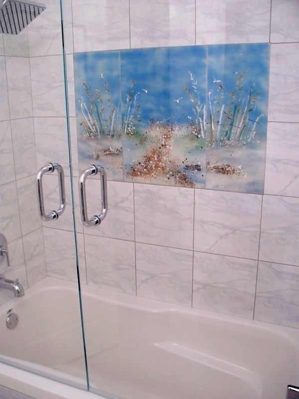 Starfire Glass for a Eclectic Bathroom with a Marble Shower Surround and Glass Shower Mural in Jack and Jill Bath by Beaglesdoitbetter