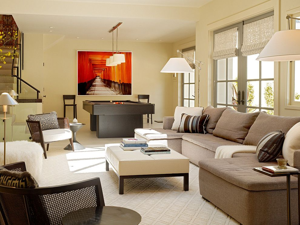 Stark Carpet for a Contemporary Family Room with a Sectional and Carriage House by Butler Armsden Architects