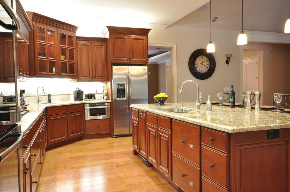 Starmark Cabinets for a Traditional Kitchen with a Breakfast Bar and Finley by the Mirror Gallery, Kitchen and Bathroom Showroom