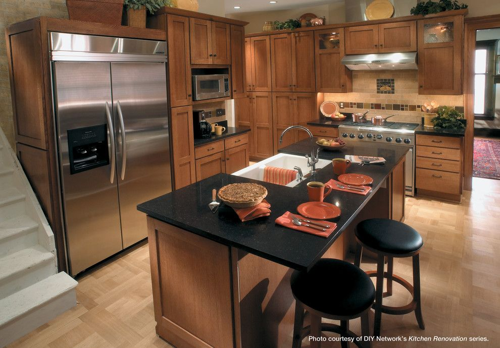 Starmark Cabinets for a Traditional Kitchen with a Cabinets and Starmark Cabinetry Kitchen in Craftsman Style by Starmark Cabinetry