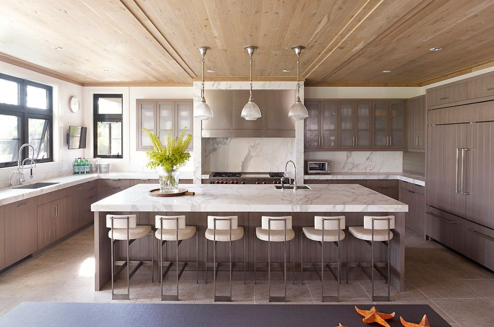 Statuary Marble for a Contemporary Kitchen with a White Pendant Lights and Hampton Beach House by Stephens Design Group