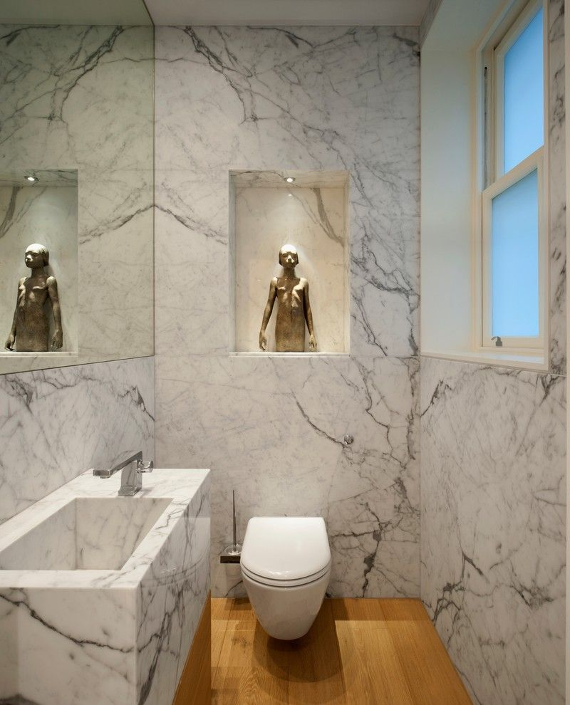 Statuary Marble for a Contemporary Powder Room with a Marble Bathroom and Luxury Apartment in Queen's Gate by Tg Studio