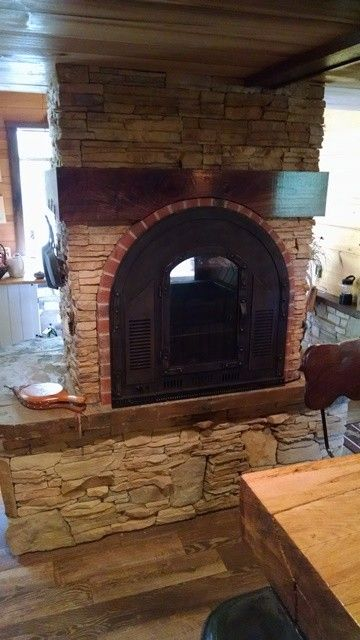 Stoll Fireplace for a Rustic Spaces with a Rustic Fireplace and See Through Fireplace Design, Side 1 by Stoneman Inc