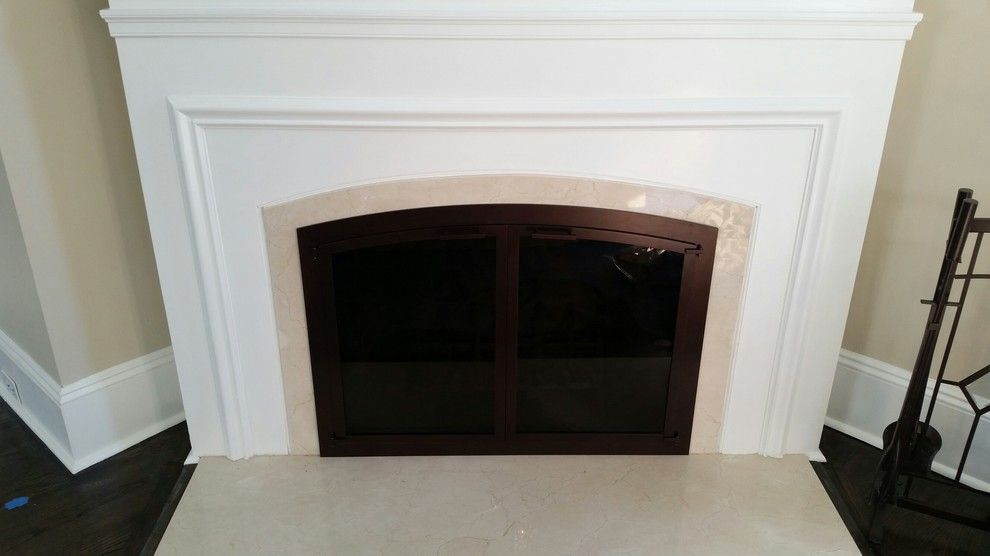 Stoll Fireplace for a Traditional Living Room with a Arch Door and Glen Rock Door by Kjb Fireplaces