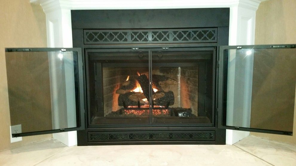 Stoll Fireplace for a Traditional Living Room with a Fireplace Door and Norwood Before & After Door by Kjb Fireplaces