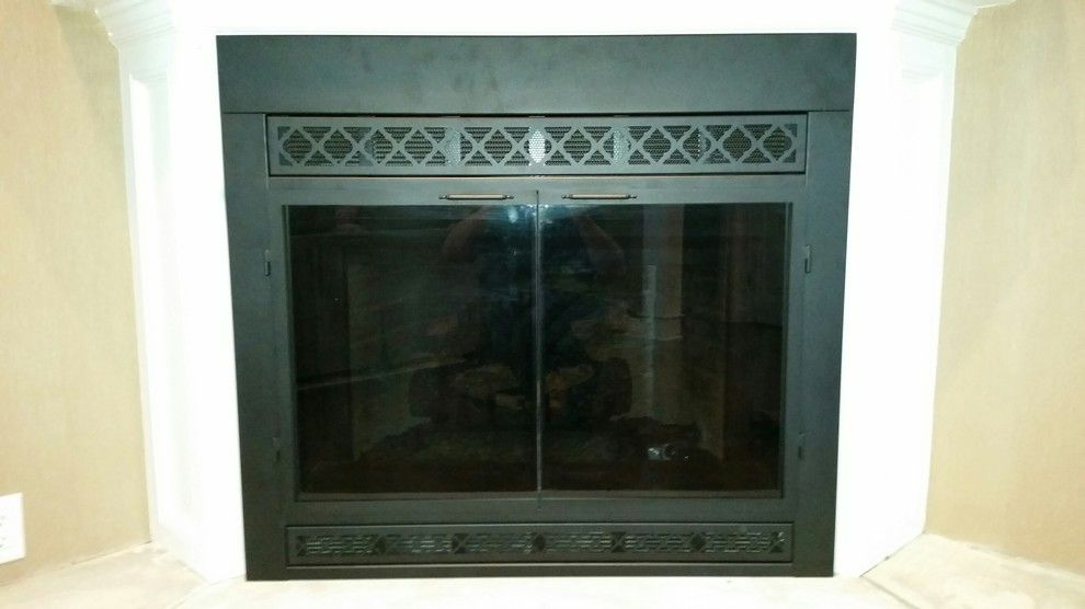 Stoll Fireplace for a Traditional Living Room with a Wood Mantel and After by Kjb Fireplaces