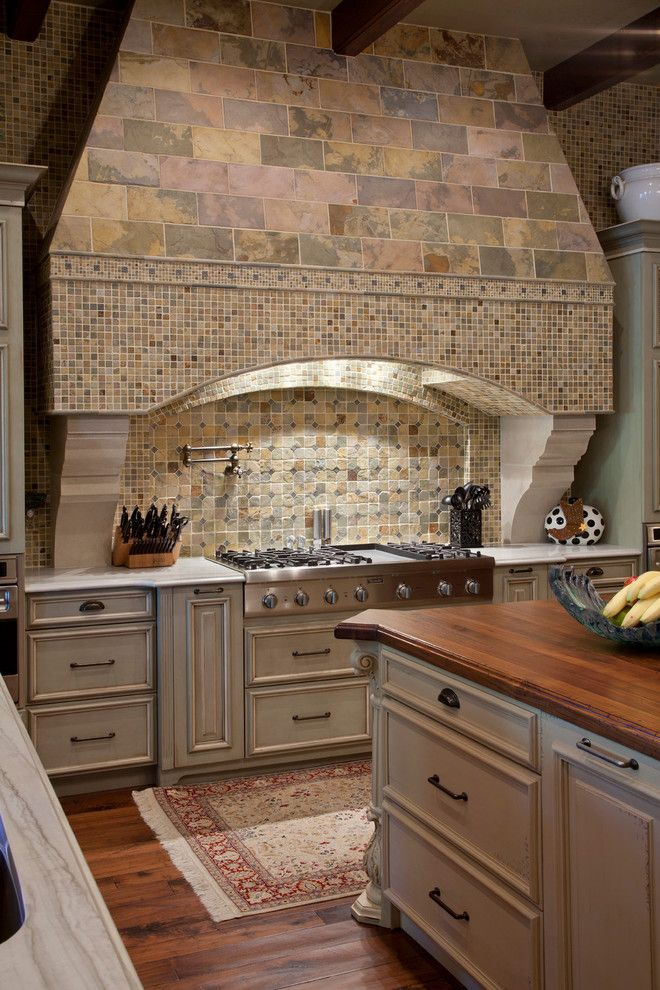 Stone Mart Tampa for a Mediterranean Kitchen with a Stone Backsplash and Odessa House by Gage Martin Interiors