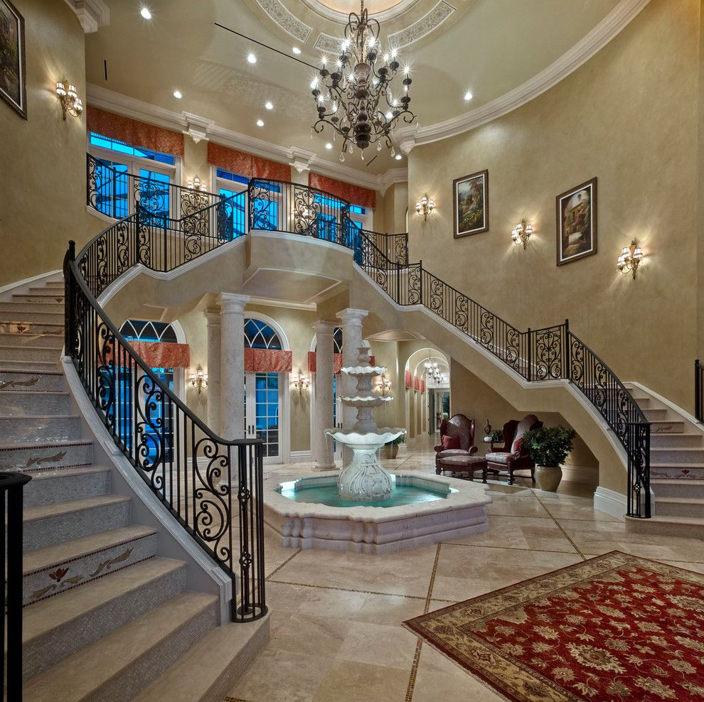 Stone Mart Tampa for a Mediterranean Staircase with a Arched Window and Mediterranean Staircase by Johncannonhomes.com