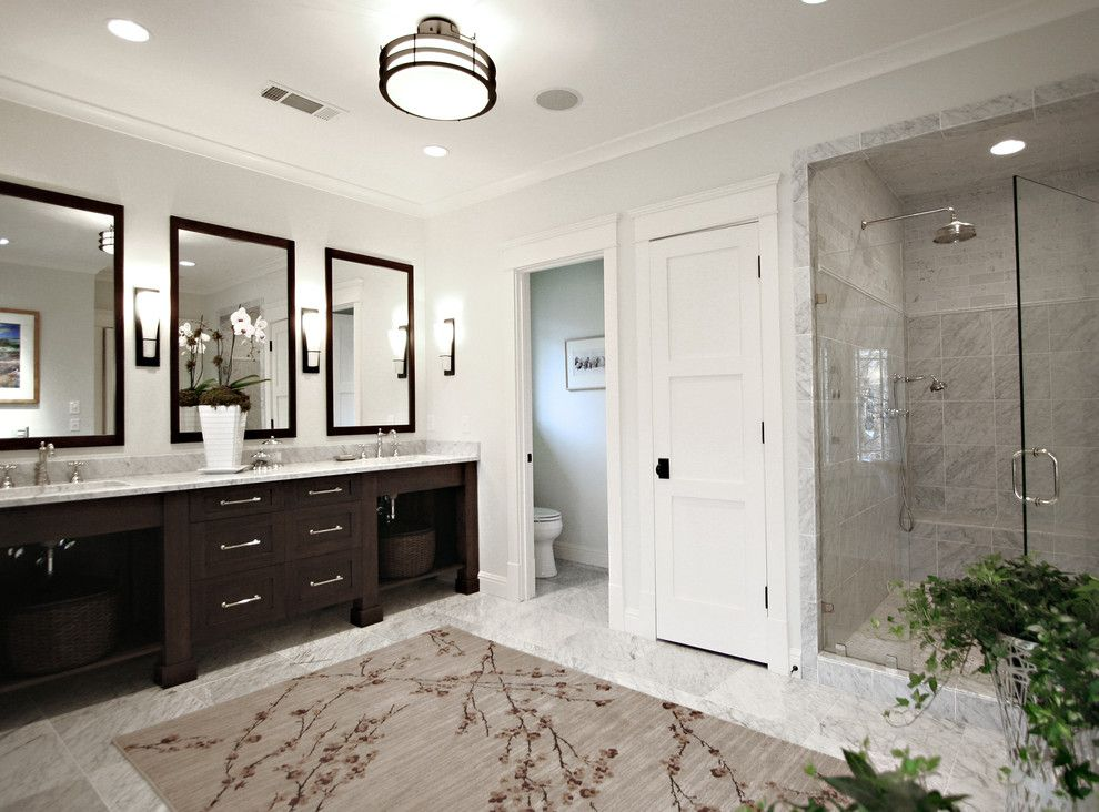 Stowers Furniture for a Traditional Bathroom with a Sconce and Arts & Crafts Bathroom by Dresser Homes