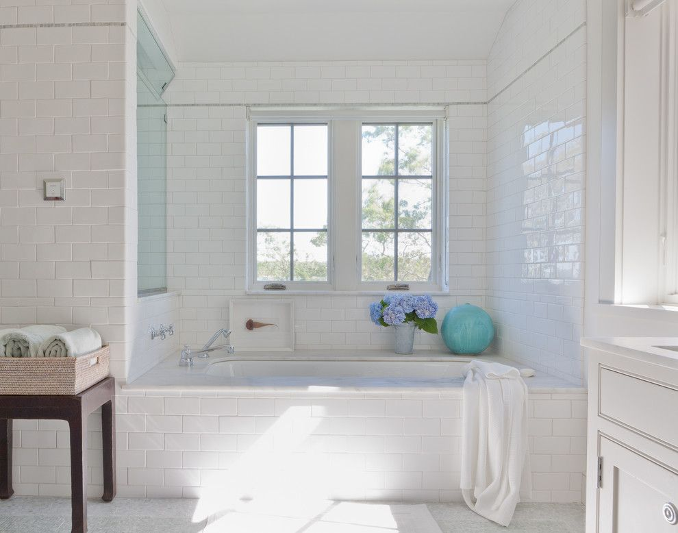 Subway Tile Patterns for a Beach Style Bathroom with a White and Shelter Island Beach House by Wettling Architects