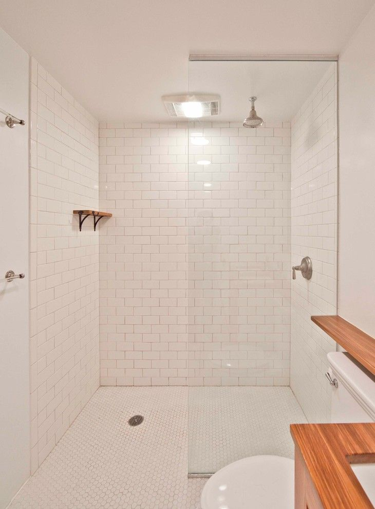 Subway Tile Patterns for a Contemporary Bathroom with a Floating Shelves and Parkslope Townhouse by Grant Davis Thompson, Inc.