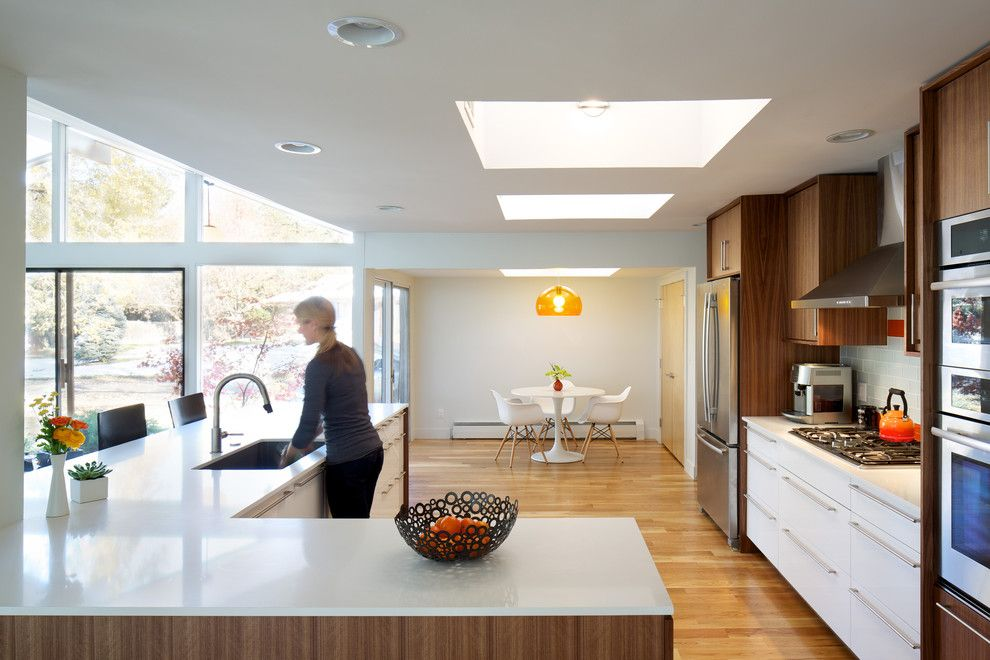 Sugatsune for a Midcentury Kitchen with a White Countertop and Hornstein Residence by Design Platform