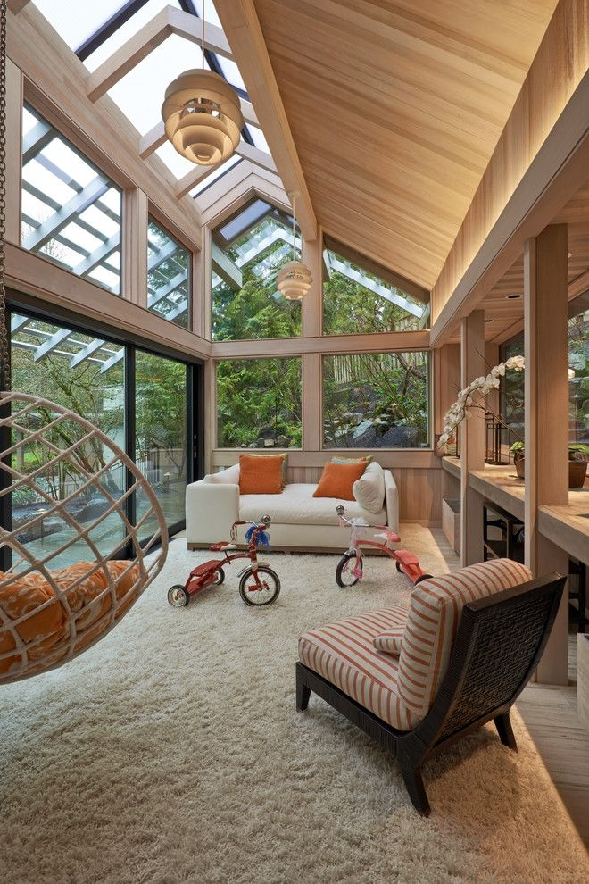 Sunroom Decorating Ideas for a Contemporary Sunroom with a Wood Ceiling and Raleigh Hills Sunroom Addition by Richard Brown Architect Aia
