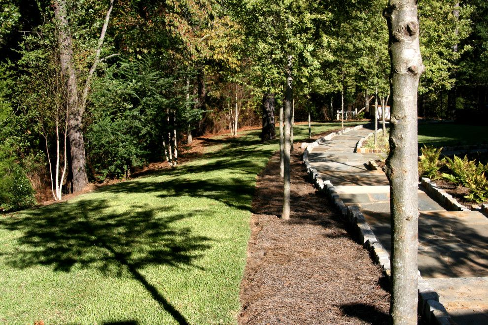 Super Sod for a Farmhouse Landscape with a Stone Path and Zenith Zoysia by Super-Sod