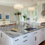 Super White Quartzite for a Contemporary Kitchen with a White Kitchen and Contemporary White by Kitchens by Design