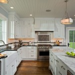 Super White Quartzite for a Farmhouse Kitchen with a Under Cabinet Lighting and Seven Gables by Balzer + Tuck Architecture