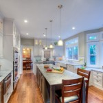 Super White Quartzite for a Traditional Kitchen with a Glass Cabinets and White and Grey Kitchen Remodel by Gloria Carlson   Harrell Remodeling, Inc.