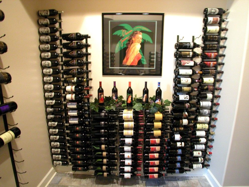 Superior Moulding for a Contemporary Wine Cellar with a Vintage View and Wine Bottle Storage by Superior Moulding of Nevada