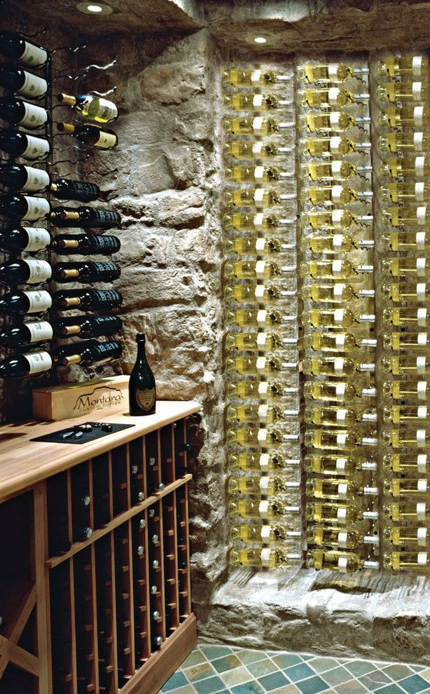 Superior Moulding for a Contemporary Wine Cellar with a Wine Racks and Wine Bottle Storage by Superior Moulding of Nevada