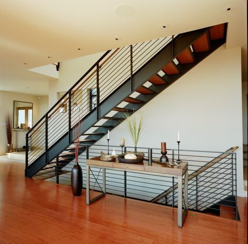 Swenson Granite for a Modern Staircase with a Recessed Lighting and Rhodes Architecture + Light by Rhodesarchitecture