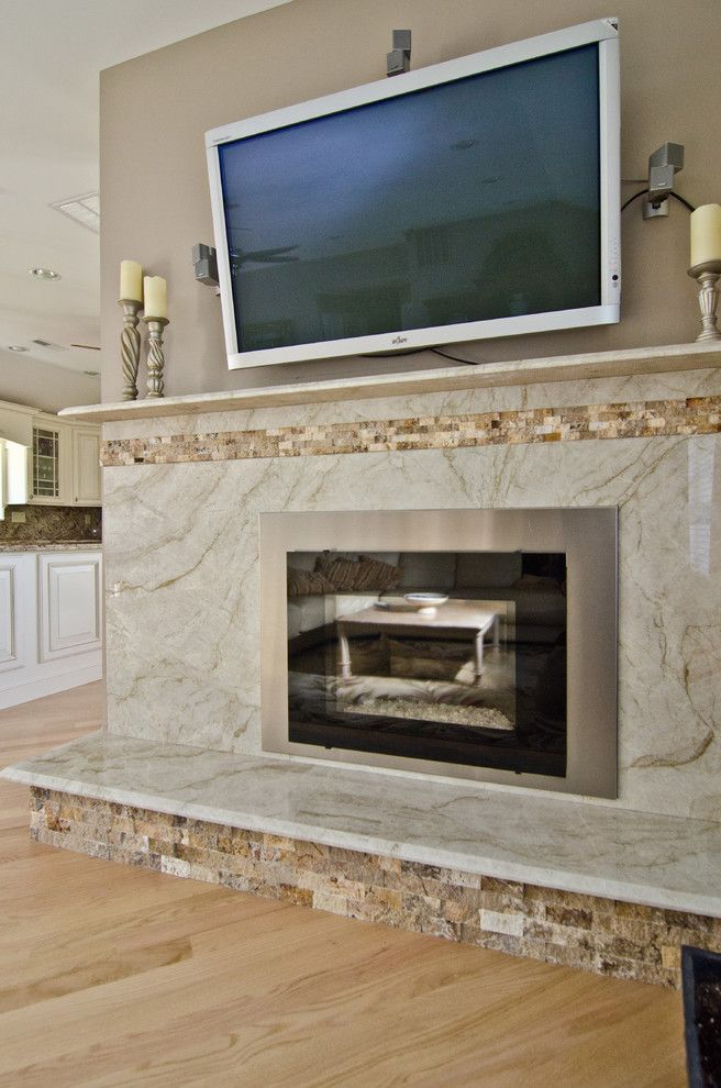 Taj Mahal Granite for a Contemporary Living Room with a Fireplace Insert and Taj Mahal Quartzite Fireplace Surround by Granite Grannies