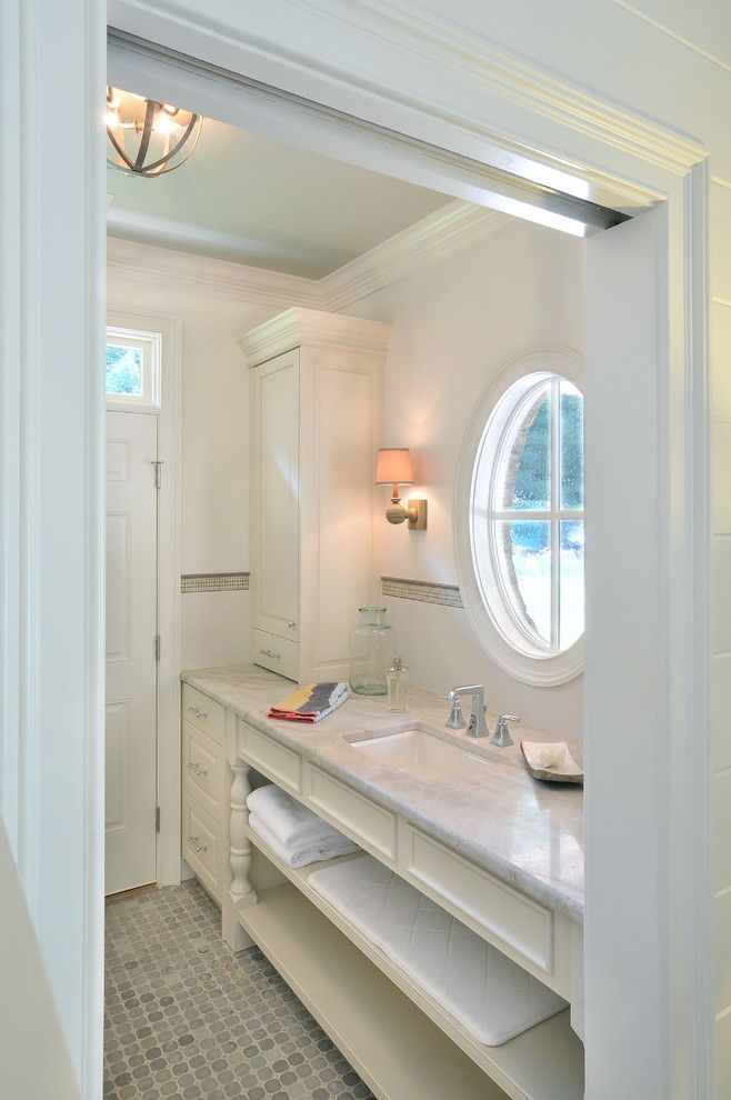 Taj Mahal Granite for a Traditional Bathroom with a Pocket Door and Pool House by Innovative Construction Inc.