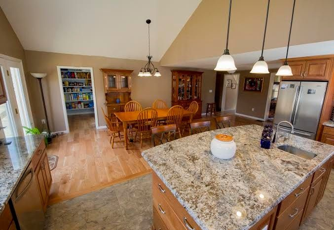 Taj Mahal Granite for a Traditional Kitchen with a Kitchen Island and Kitchen Remodeling by Razzano Homes and Remodelers, Inc.