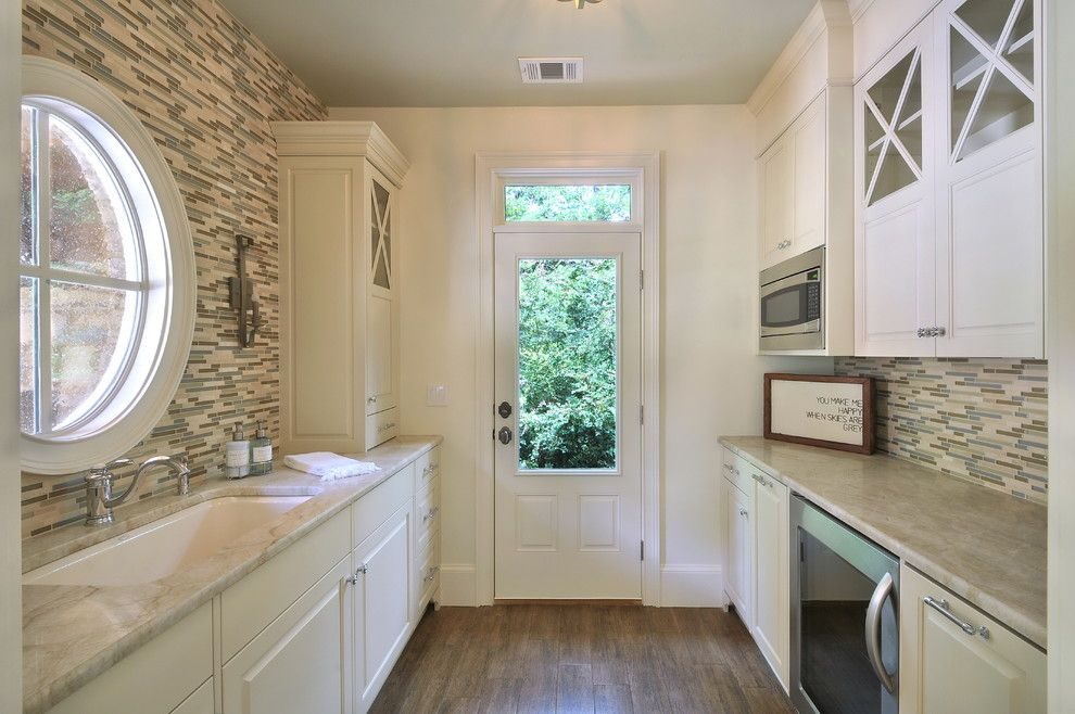 Taj Mahal Granite for a Traditional Kitchen with a Round Window and a New Pool House in North Atlanta by Cynthia Karegeannes, Registered Architect
