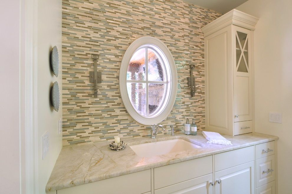 Taj Mahal Granite for a Traditional Kitchen with a Sconces and Pool House by Innovative Construction Inc.