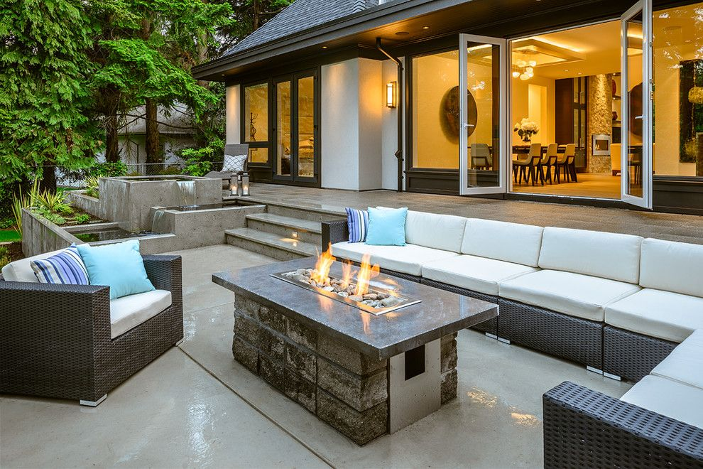 Tankless Water Heater vs Tank for a Contemporary Patio with a Fire and Water Features and Midland by Christopher Developments