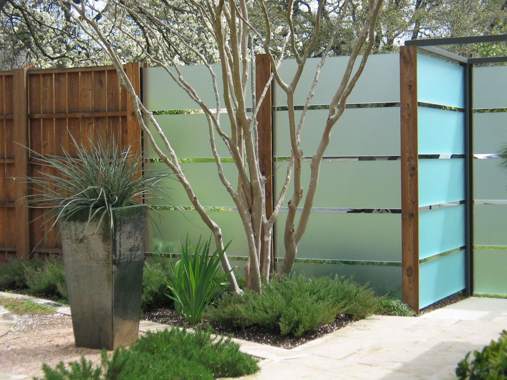 Tap Plastics for a Contemporary Landscape with a Potted Plants and Courtyard by Tim Cuppett Architects