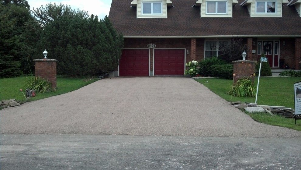 Tar and Chip Driveway for a Rustic Spaces with a Eco Paving and Tar and Chip Ottawa by Tar and Chip Ottawa