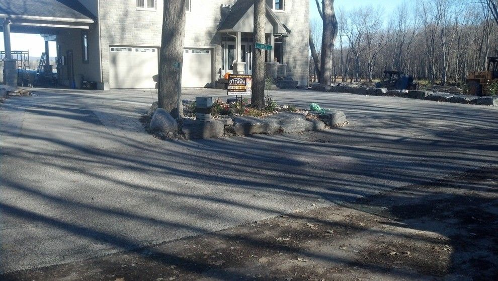 Tar and Chip Driveway for a Rustic Spaces with a Natural Driveway and Tar and Chip Ottawa by Tar and Chip Ottawa