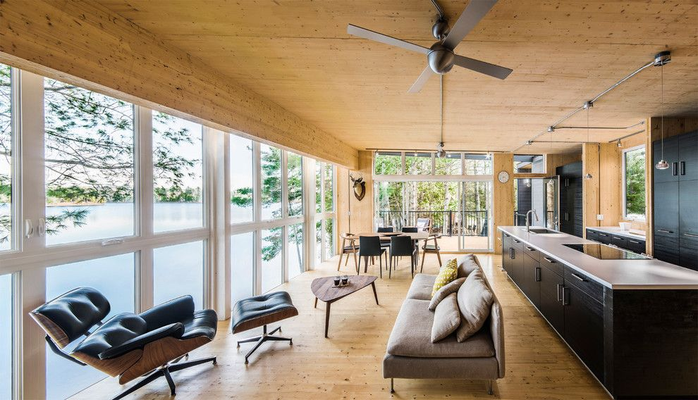 Texas Casual Cottages for a Contemporary Living Room with a Dark Wood Kitchen and La Peche Cottage - Kariouk & Associates by Photolux Commercial Studio