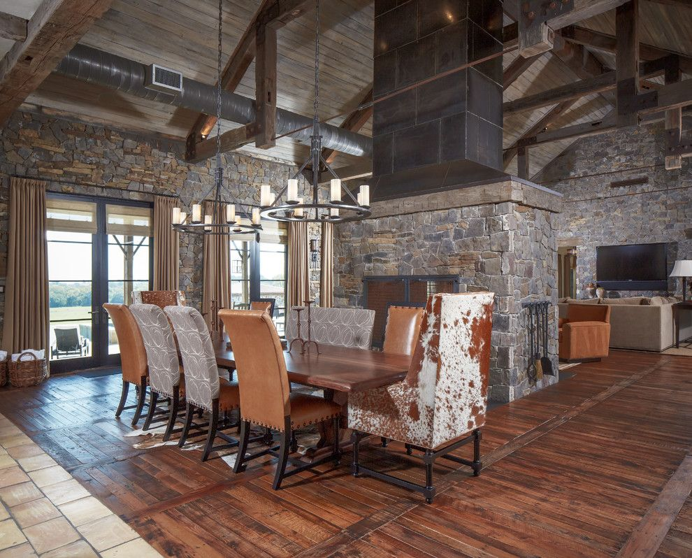 Texas Tool Traders for a Rustic Dining Room with a Cow Hide Upholstery and Ranch by Thompson Custom Homes