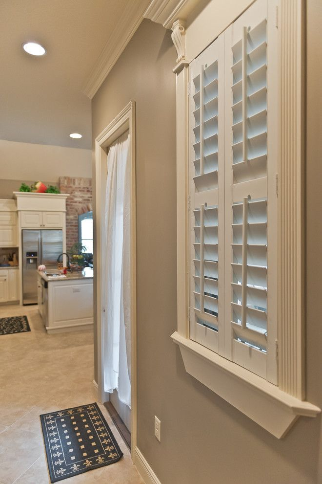 The Louver Shop for a Traditional Spaces with a Arch and S. Harvey Home, Lake Charles by the Louver Shop of Lake Charles